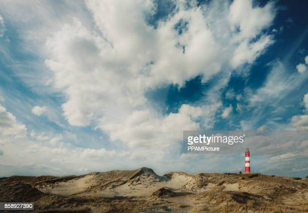 coast landscape with a lighthouse, island of amrum - dramatic sky stock pictures, royalty-free photos & images