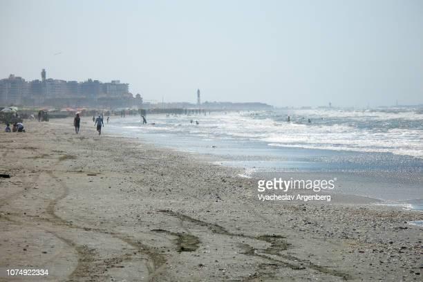coast of the mediterranean sea in port said, egypt - argenberg stock-fotos und bilder