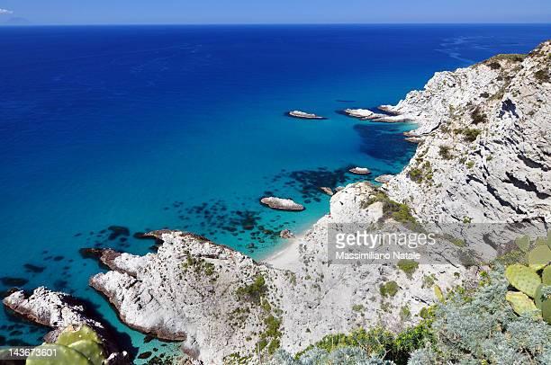 coast of tropea blue sea with still rocks - calabria fotografías e imágenes de stock