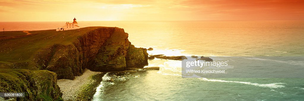 Coast with the lighthouse Stoer Head at sunset (Scotland) : Stock Photo