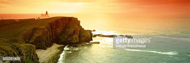 Coast with the lighthouse Stoer Head at sunset (Scotland)