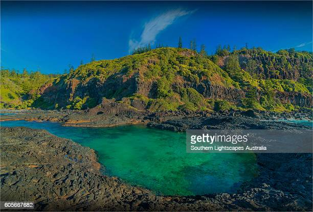 Coastal area at the foot of steep cliffs know locally as the Chord, Norfolk Island south pacific ocean.