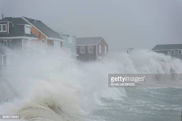 Coastal areas in New England are bracing for the high tide that is scheduled to be at it's highest as seen in Scituate Massachusetts before receding...