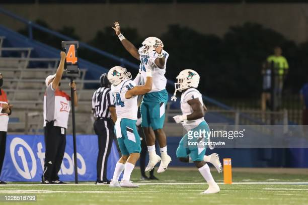 Coastal Carolina Chanticleers linebacker Nic Burroughs-Rogers leaps to celebrate a 2-yard touchdown reception in the first quarter of a college...