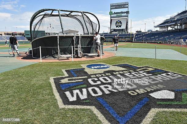 Coastal Carolina Chanticleers players take batting practice prior to playing the Arizona Wildcats in game one of the College World Series...