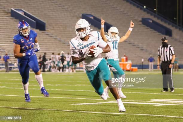 Coastal Carolina Chanticleers tight end Isaiah Likely takes a 2-yard pass while quarterback Grayson McCall signals touchdown in the second quarter of...