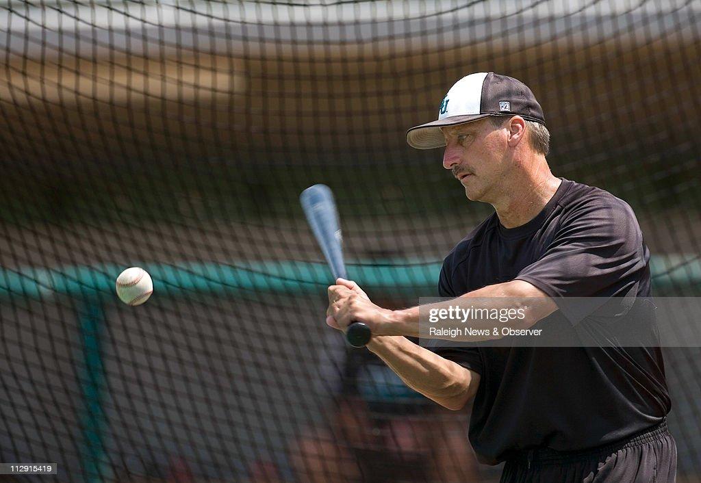Coastal Carolina head coach Gary Gilmore bats for infield