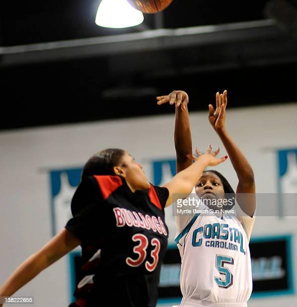 Coastal Carolina's Shatia Cole takes a shot over GardnerWebb's Jasmine Dale during the first half at Kimbel Arena in Conway South Carolina on...