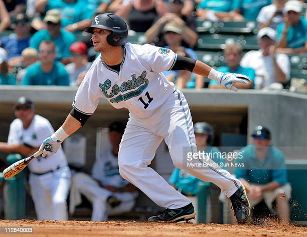 Coastal Carolina's Tommy Stella hits a single in the second inning against Stony Brook in Game 1 of the NCAA Division I Baseball Championship Myrtle...