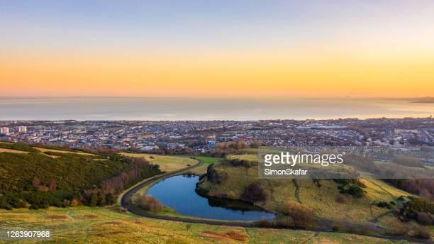 coastal city at sunset, edinburgh uk - morning stock pictures, royalty-free photos & images