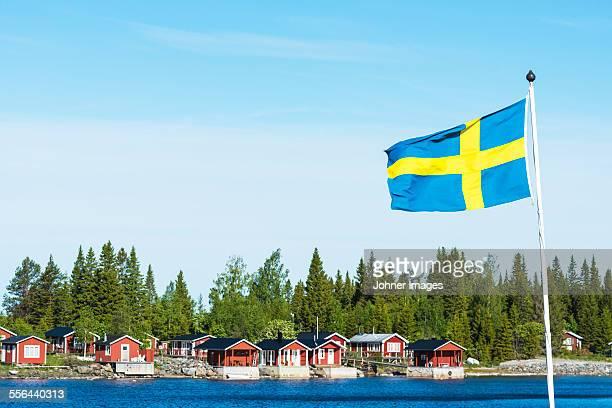 Coastal houses, Swedish flag on foreground