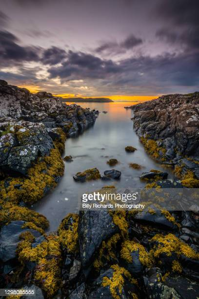 coastal inlet at sunset - western isles stock pictures, royalty-free photos & images