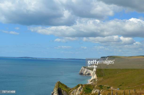 coastal landscape, lulworth cove, dorset, england, uk - english channel stock photos and pictures