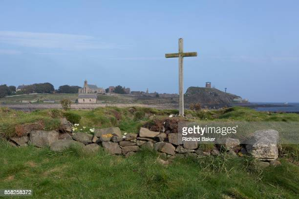 Coastal landscape of St. Cuthbert's Island on Holy Island and in the distance, left, the St. Mary's church and the remains of the early 12th century...