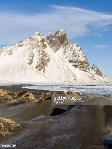 Coastal landscape with dunes at Stokksnes during winter on a stormy day Europe northern Europe Iceland February