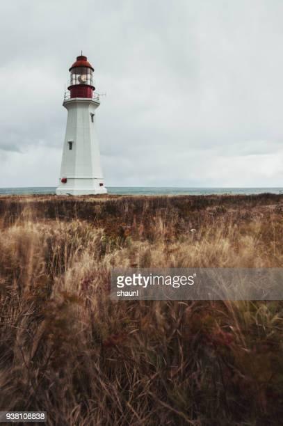 coastal lighthouse - cape breton island stock pictures, royalty-free photos & images