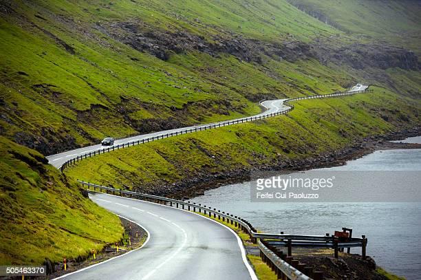 Coastal mountain road at Funningsfjordur of Eysturoy Island in Faeroe Islands