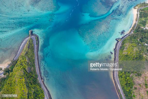 coastal road along turquoise lagoon, aerial view, baie du cap, mauritius - indian ocean stock pictures, royalty-free photos & images