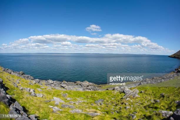 coastal road. atlantic way. ireland - horizon over water stock pictures, royalty-free photos & images