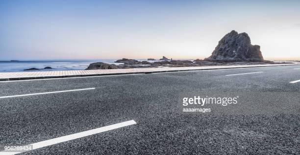 coastal road by rialto beach against purple sky - 海岸線 ストックフォトと画像
