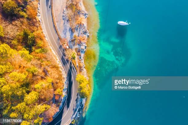 coastal road on lake thun, switzerland - draufsicht stock-fotos und bilder