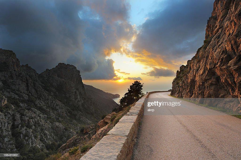 Coastal Road on the Island of Corsica at Sunset : Stock Photo