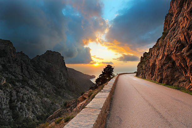 Coastal Road On The Island Of Corsica At Sunset Wall Art