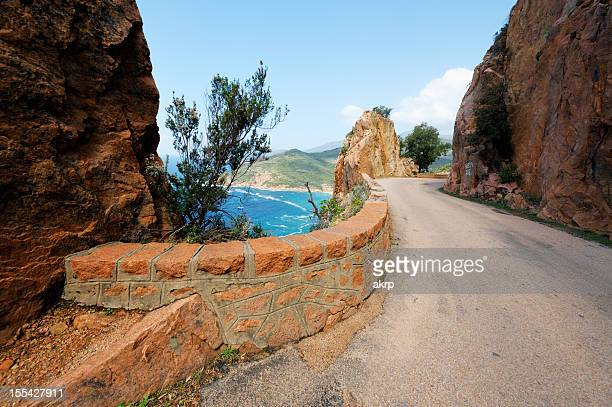 coastal road on the island of corsica - bouches du rhone stock pictures, royalty-free photos & images