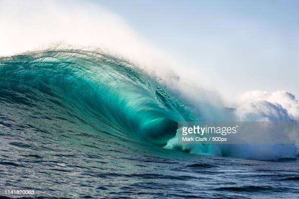 coastal scene - big wave surfing stock pictures, royalty-free photos & images
