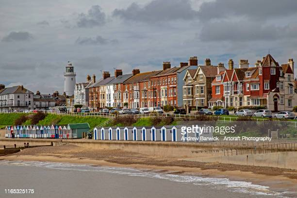 coastal scene - beach hut stock pictures, royalty-free photos & images