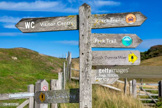 coastal signpost. seven sisters, uk - eastbourne stock pictures, royalty-free photos & images