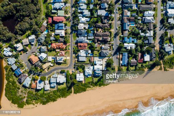 coastal suburb overhead perspective roof tops - housing development stock pictures, royalty-free photos & images