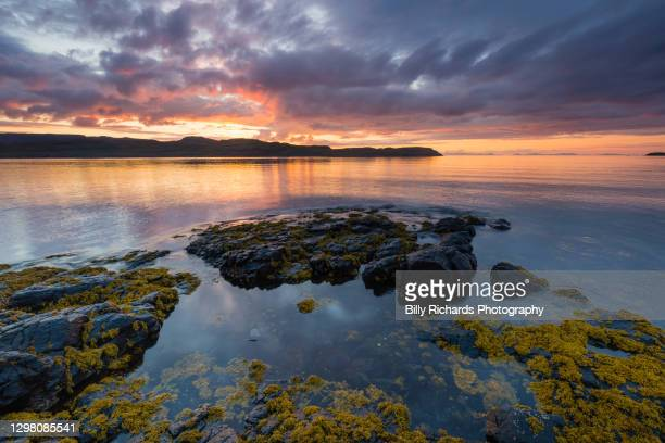 coastal sunset with rocky shore - seascape stock pictures, royalty-free photos & images