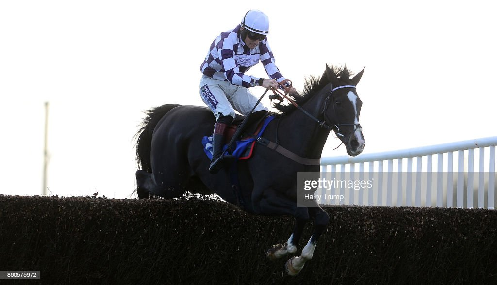 Coastal Tiep ridden by Sam Twiston Davies jump the last on their way to winning during the Great Point Media Beginners' Chase at Exeter Racecourse on October 12, 2017 in Exeter, England.