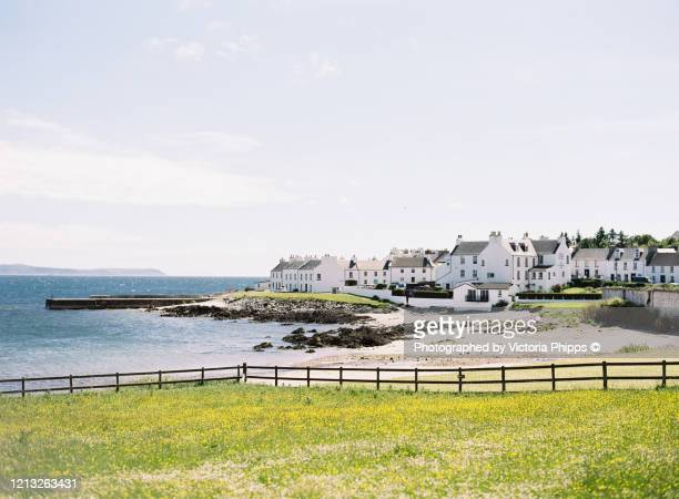coastal town of port charlotte, islay on a summer's day - harbour stock pictures, royalty-free photos & images