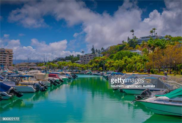 coastal view and recreational boats, city of noumea, new caledonia, south pacific. - new caledonia stock photos and pictures