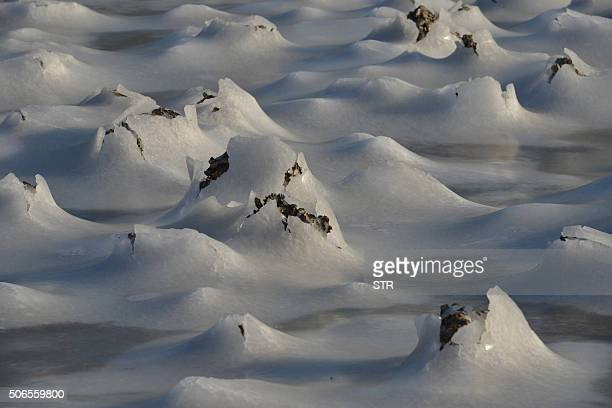 Coastal waters are frozen in Qingdao in eastern China's Shandong province on January 24 2016 Much of China shivered on January 23 as a...