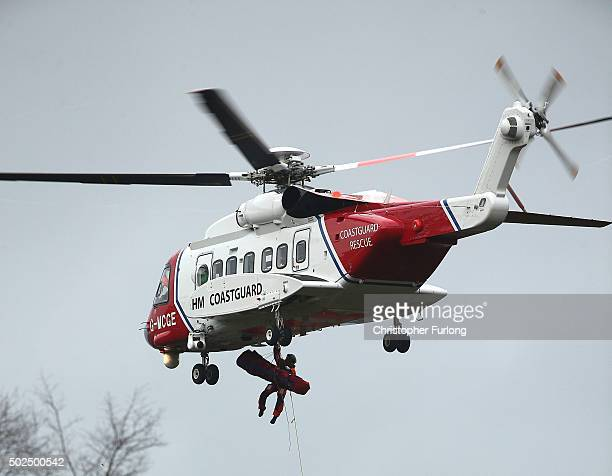 Coastguard helicopter carries out a rescue operation as floodwaters rise after rivers burst their banks on December 26 2015 in Mytholmroyd England...