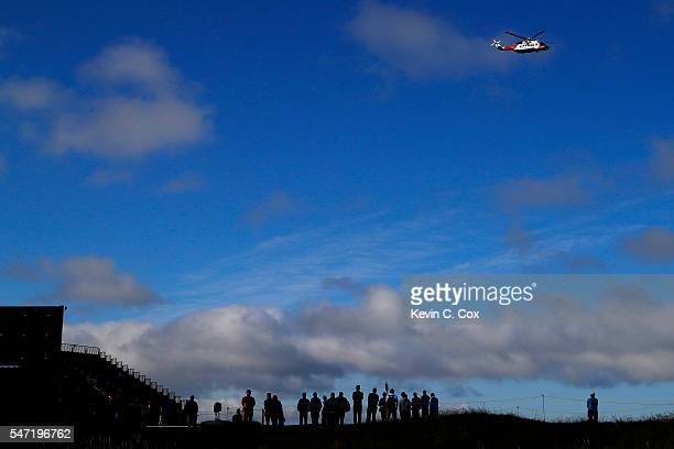 A coastguard helicopter is seen over the 5th green during the first round on day one of the 145th Open Championship at Royal Troon on July 14 2016 in...