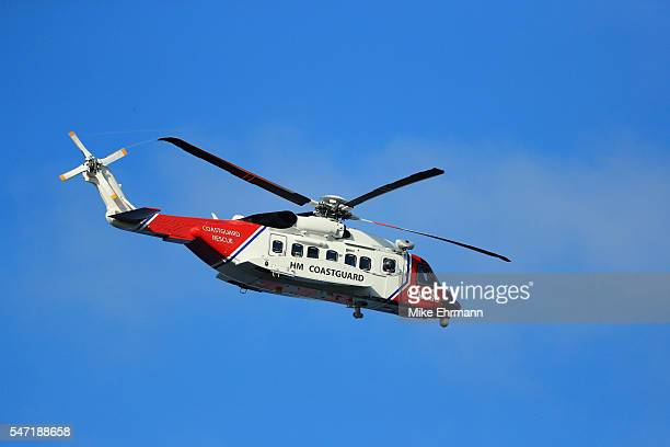 A coastguard helicopter is seen overhead during the first round on day one of the 145th Open Championship at Royal Troon on July 14 2016 in Troon...