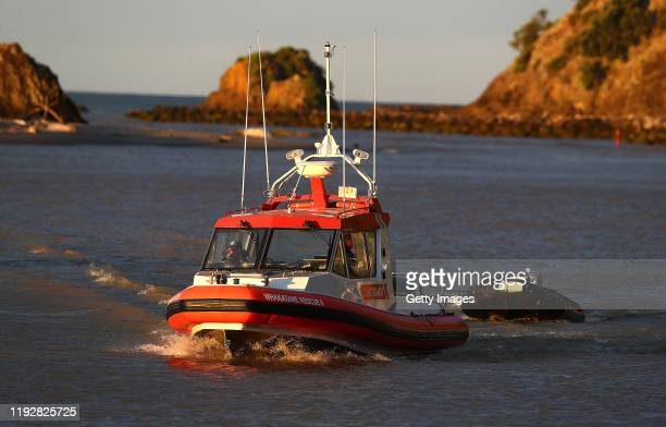Coastguard rescue boats are pictured arriving at the marina near Whakatane on December 09 2019 in Whakatane New Zealand One person has died several...