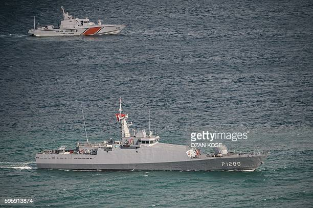 A coastguard ship and a Turkish navy vessel patrol on the Bosphorus on August 26 2016 in Istanbul during the opening cerenomy of the Yavuz Sultan...