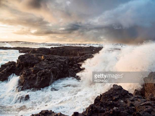 Coastline at Brimketill during stormy conditions at sunset The coast of the north atlantic on Reykjanes peninsula during winter Northern Europe...
