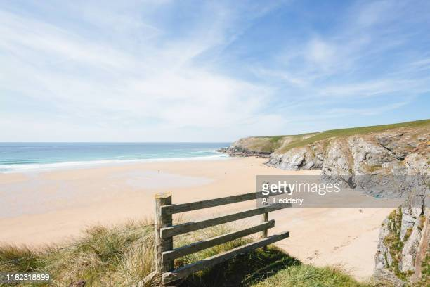 coastline at holywell bay - bay of water stock pictures, royalty-free photos & images