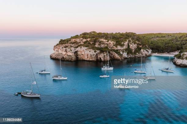 coastline at sunrise, cala macarella, menorca - ミノルカ ストックフォトと画像