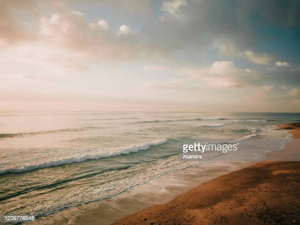 coastline at sunrise - generic location stock pictures, royalty-free photos & images