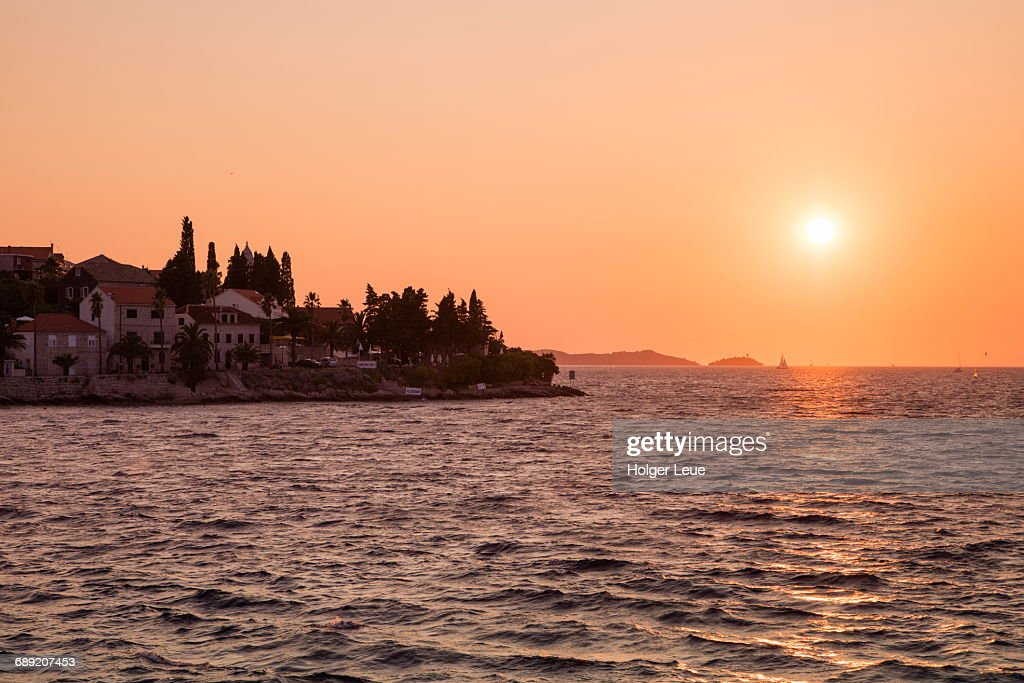 Coastline at sunset seen from pier at Old Town : Stock Photo