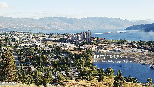 coastline cityscape with mountain range in background - kelowna stock pictures, royalty-free photos & images