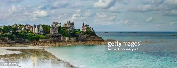 coastline in old french city, bretagne. luxury villas and low tide water. - dinard stock pictures, royalty-free photos & images