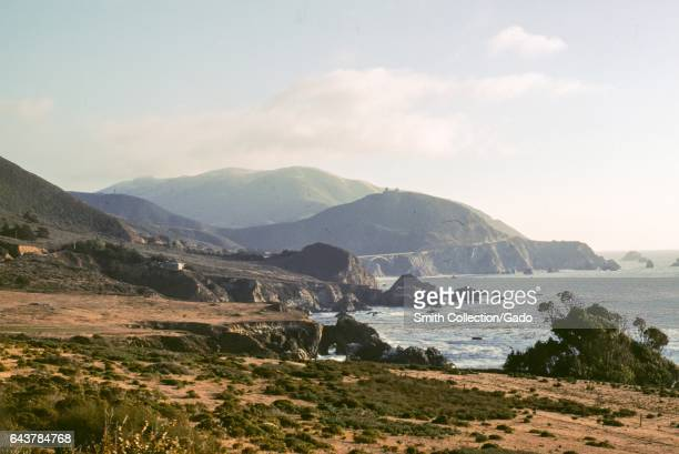 Coastline near Monterrey California with the iconic Bixby Bridge visible in the distance 1978